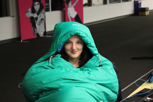 Student in sleeping bag
