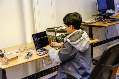 Young student with hardware project
